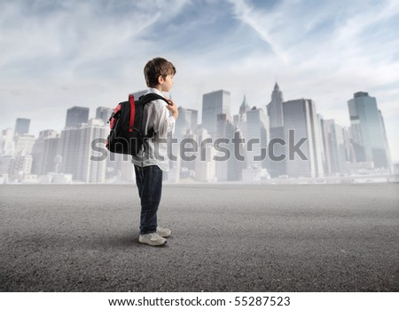 Child with rucksack with cityscape on the background - stock photo