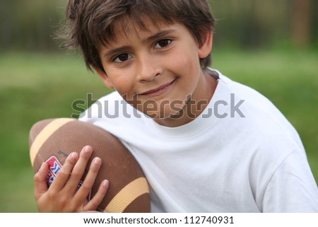 Child with rugby ball