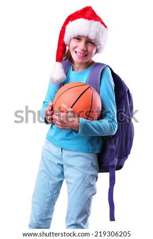 Child with Santa Claus red hat and ball. Christmas, New Year, holiday activities, sports celebration - stock photo