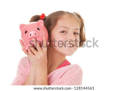 child with savings in piggy bank, banking concept - stock photo