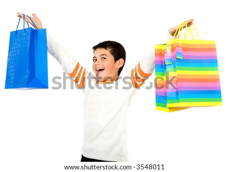 child with shopping bags smiling - isolated over a white background