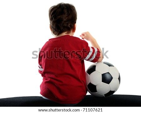 child with soccer ball sitting back a over white background - stock photo