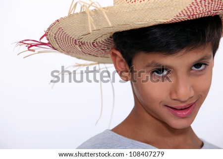 Child with Straw Hat - stock photo