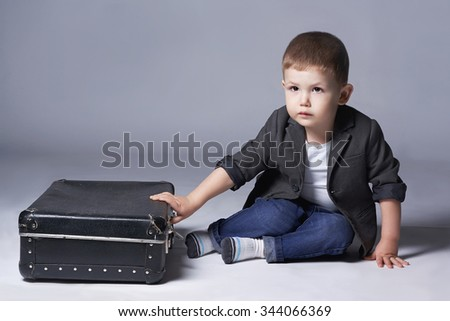 child with suitcases. stylish little boy.2 years old