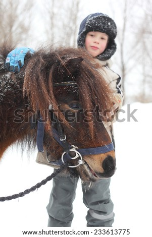 child with the little horse - stock photo