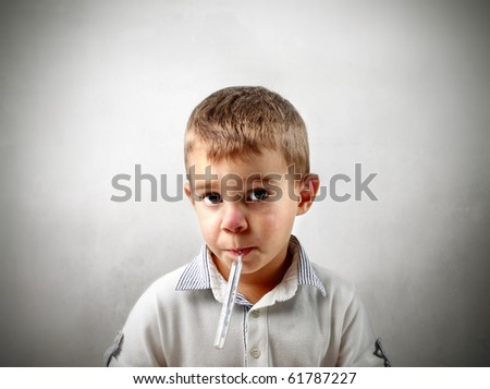 Child with thermometer in his mouth