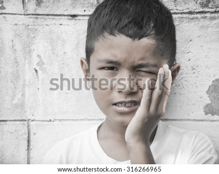 child with toothache - stock photo