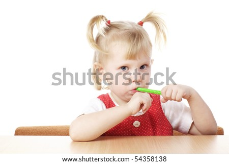 child with toothbrush in hands - stock photo