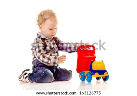 child with toy isolated on a white background
