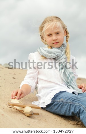 Child with toy outdoors - stock photo