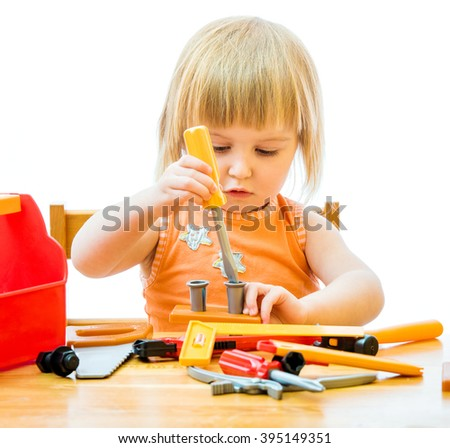 child with toy tools - stock photo