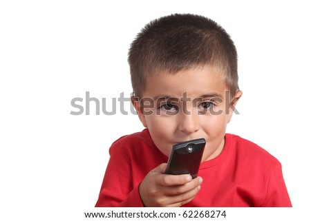 child with tv remote control - stock photo