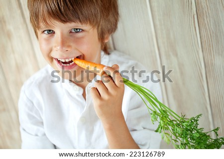 Child with vegetable - stock photo