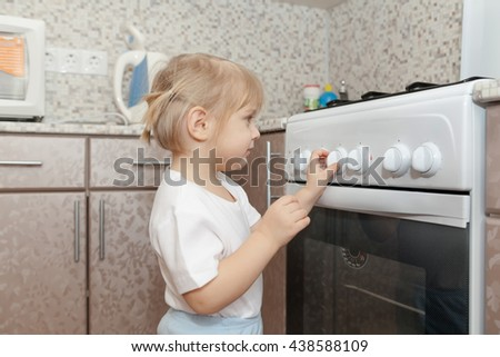 child without supervision of parents playing with  stove