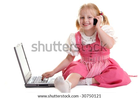 Child working on computer and having telephone call - stock photo