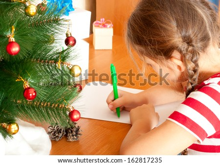 child write a letter to Santa Claus