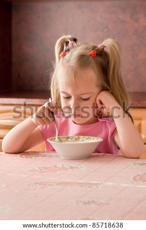 Child 3.5 years did not want to eat breakfast - stock photo