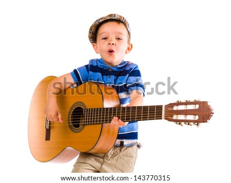 Child, 5 years old, plays guitar with emotion, white background - stock photo