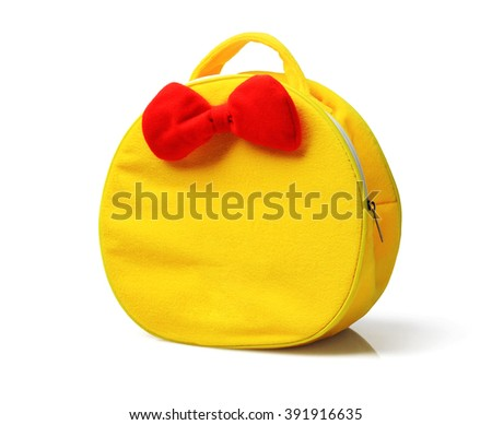 Child Yellow Hand Bag with Red Ribbon on White Background - stock photo