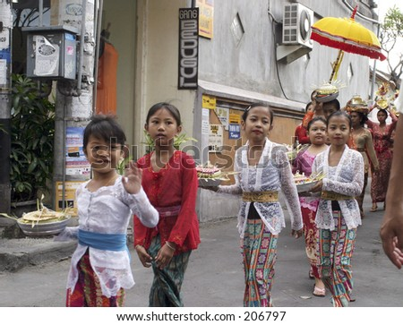 Childerns in an offer procession in Kuta, Bali - stock photo