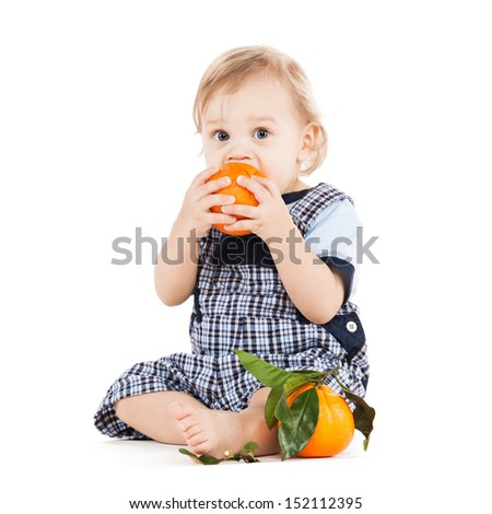 childhood and healthy food concept - cute toddler eating orange - stock photo