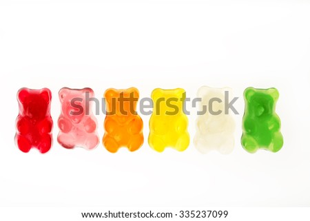 Childhood and jelly bears candies isolated on white background - stock photo