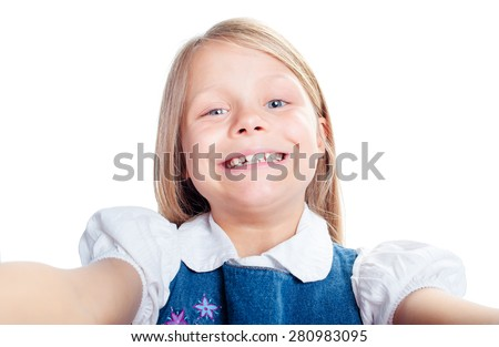 Childhood and technology. Close up portrait of pretty little girl taking selfie. Isolated on white. - stock photo