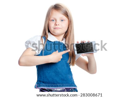 Childhood and technology. Cute little girl pointing smartphone screen with copy space on it. Isolated on white. - stock photo