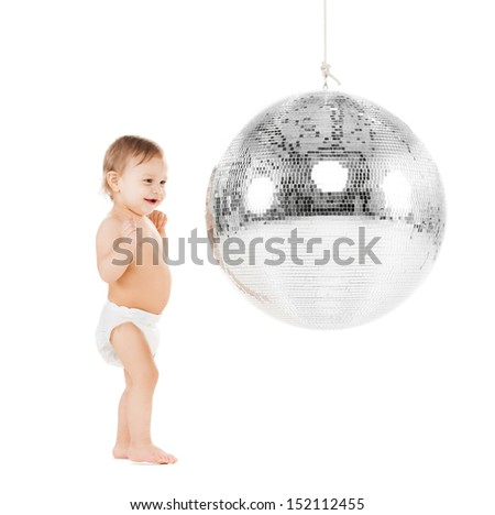 childhood and toys concept - cute little toddler playing with disco ball - stock photo