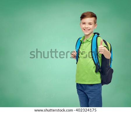 childhood, education and people concept - happy smiling student boy with school bag over green school chalk board background - stock photo
