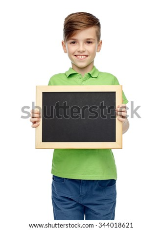 childhood, education, school, advertisement and people concept - happy smiling boy in green polo t-shirt holding black blank chalk board - stock photo
