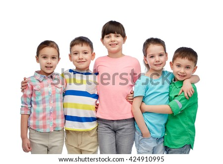childhood, fashion, friendship and people concept - group of happy smiling little children hugging - stock photo