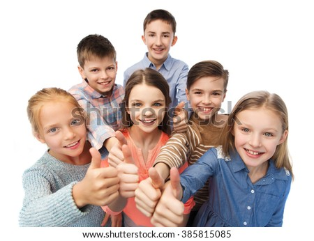 childhood, fashion, gesture and people concept - happy smiling children showing thumbs up - stock photo