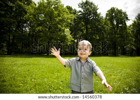 Childhood. Happy Baby Boy Playing Outdoors. - stock photo