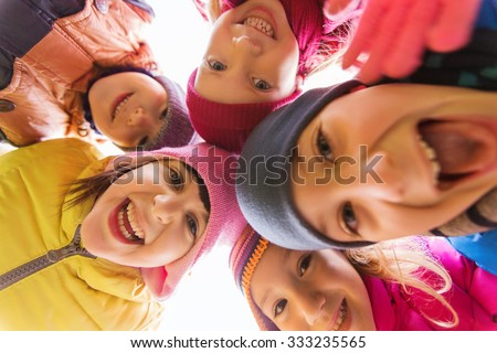 childhood, leisure, friendship and people concept - group of happy children faces in circle - stock photo