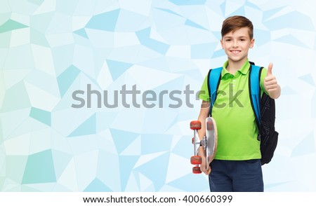 childhood, leisure, gesture, school and people concept - happy smiling student boy with backpack and skateboard showing thumbs up over blue low poly texture background - stock photo