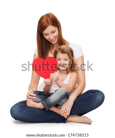 childhood, parenting and relationship concept - happy mother with adorable little girl and red heart - stock photo
