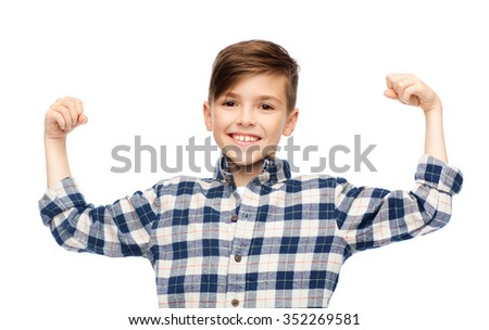 childhood, power, strength and people concept - happy smiling boy in checkered shirt showing strong fists - stock photo