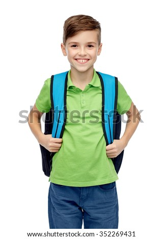 childhood, school, education and people concept - happy smiling student boy with school bag - stock photo