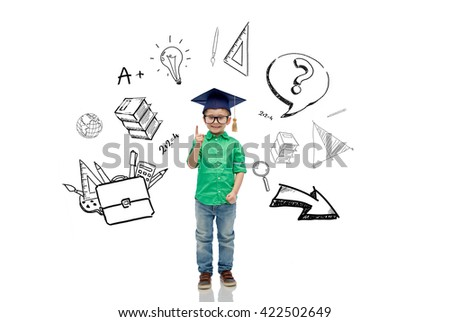 childhood, school, education, knowledge and people concept - happy boy in bachelor hat or mortarboard and eyeglasses pointing finger up with doodles - stock photo