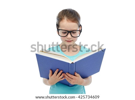 childhood, school, education, vision and people concept - happy little girl in eyeglasses reading book - stock photo