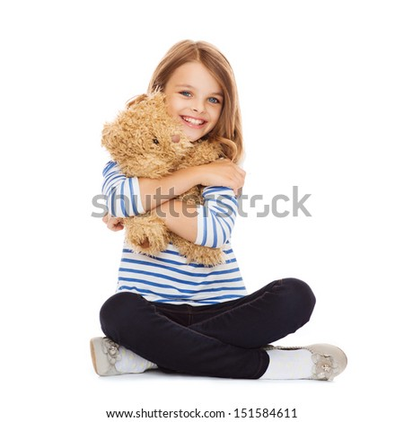 childhood, toys and shopping concept - cute little girl hugging teddy bear - stock photo