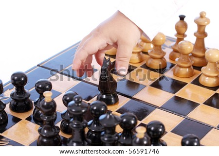 Childre hand with chess, isolated in white - stock photo