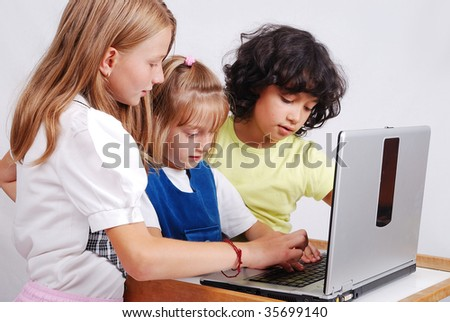 Children activities on laptop put on desk, isolated