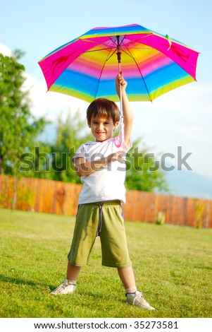 Children activity, umbrella, summer, play, funny - stock photo
