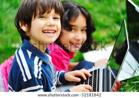 Children activity with laptop in nature - stock photo