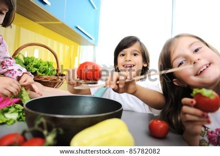 Children alone in the kitchen - stock photo