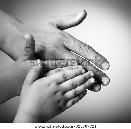children and adults hands on a white background - stock photo