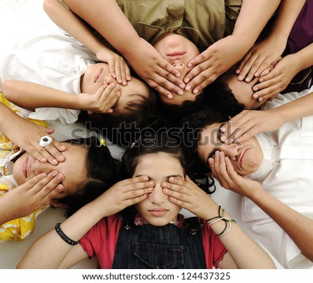 Children and teenagers covering their eyes