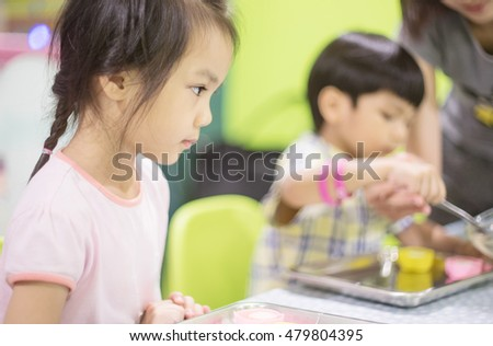 Children are learning cooking in a kid cooking class